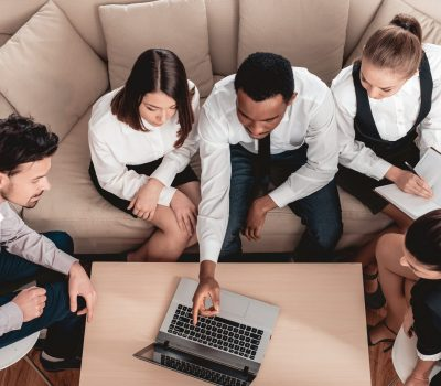 Top,View.young,Multiracial,Team,Gathered,In,Office,Around,Laptop,To