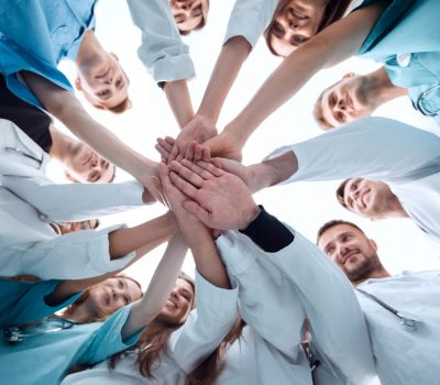 Bottom,View.,A,Group,Of,Medical,Colleagues,Putting,Their,Hands